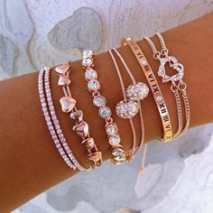 jewelry This elegant Rose Gold Everything bracelet set includes: a wrap crystal cuff a multi-heart bracelet a round cz crystal tennis bracelet a double cz disco ball bracelet a Roman numeral Rose Gold Jewelry, Diamond Jewelry, Gold Jewellery, Designer Jewellery, Jewellery Shops, Zales Jewelry, Rose Gold Shoes, Diamond Stud, Temple Jewellery