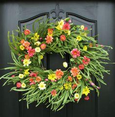 Colorful floral spring wreath - beautiful! http://www.drivenbydecor.com/2016/03/front-door-decor-spring-easter-wreaths.html?utm_source=feedblitz&utm_medium=FeedBlitzRss&utm_campaign=drivenbydecor