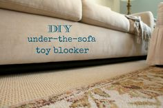 Rachel's Nest: DIY Under-the-Sofa Toy Blocker; This could keep the kittens out from under the couch as well as their toys.