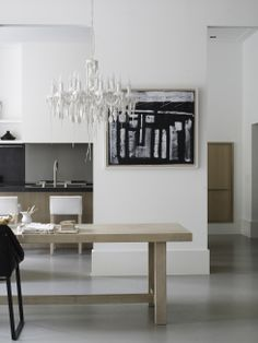 contemporary kitchen in white, blonde wood and charcoal - Piet Boon Styling by Karin Meyn   Styling with artistic objects, black Kekke chair; Piet Boon collection