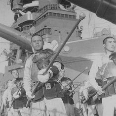 "japanese imperial navy battleship crew during exercises - they are traininig ""JUKENJUTSU"" juken=rifle with bayonet, jutsu=war. They have an armour called ""BOGU"" similar at the KENDO with a protection for shoulder and a ""MOKUJU"" represent a rifle but entirely wood and finally a ""KUTE"" hand protection as a glove."