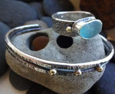 Recent custom made pieces: blue sea glass ring with reticulated silver and 18kt gold, and hammered fine silver cuff with 18kt gold accents