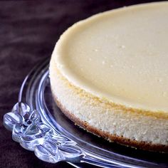 Vanilla Cheesecake. So delicious and creamy. Mine turned out beautifully without the marie bain. I also used vanilla extract rather than vanilla beans. Very easy to make. I increased the crust by 1/2 and made it go up the sides more. Mmmmmm...