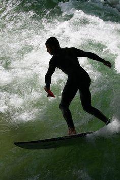 Surfing in rapid of Eisbach, Munich