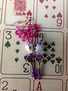 Purple sugarskull earrings by MerPrinceCloset7 on Etsy, $8.00