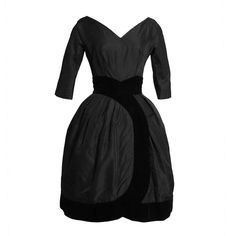 1959 Christian Dior Black Cocktail Dress with Velvet Trim   v neck.  wrap skirt, and 3/4 sleeves