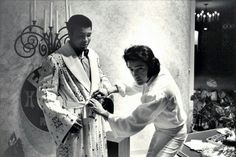 Elvis presents Muhammad Ali, training for his defense against Joe Bugner, with a robe. Ali thanked Elvis and went directly to the Las Vegas Convention Center to beat Joe Bugner.