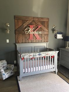 Here is Kieran's vintage airplane Nursery, which we are so proud of. There are many custom touches, such as barn doors lovingly made by Kieran's grandfather. It is a cozy, functional, beautiful space for our second born son. We love the pops of red. Rustic Baby Nurseries, Rustic Nursery Decor, Baby Room Decor, Nursery Room, Girl Nursery, Nursery Ideas, Red Nursery, Modern Nurseries, Room Ideas
