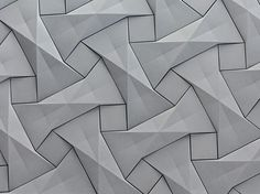 """Photo: The 3rd piece in Concurrent Constellations: presenting concrete origami tile design 'Quadilic' by Ilan Garibi for KAZA   This model is a progression from a basic paper tessellation of a molecule. Its shape, being as far removed as possible from the classic rectangle, creates a mesmerizing vision of shifting squares, giving rise to its name.   """"As an origami artist and designer, I love to find applications that exceed the potential of paper. This model is created by four diagonal lines…"""