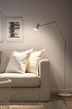 IKEA NYMÅNE FLOOR LAMP Sleek and minimalist with a slight industrial edge, this floor lamp is ideal for those looking for a reading lamp next to the sofa, or some extra light in a room's corner. The level of light packs a punch for the size, but it's not overwhelming. A great price point for good quality and timeless design!