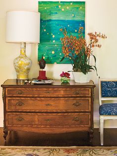 A large painted canvas gives this formal entryway a splash of contemporary color and personality. (Photo: Laurey W. Glenn)