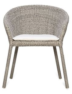 """Paola Navone's Strada collection for Janus et Cie epitomizes laid-back luxe. The extensive range of tables and seating is offered in four different shades of weather- resistant synthetic fiber, handwoven on powder-coated stainless-steel frames. Shown in Dapple, the dining armchair measures 31.5"""" h. x 26.5"""" w. x 24"""" d. and costs $1,050. janusetcie.com"""