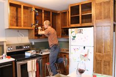 Émilie's husband building the cabinets and an all important glass of wine.