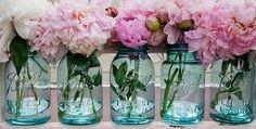 Vintage ball jars used as vases for peonies.. .