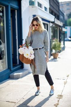 Long sweater tunic/silver and black belt/jeans/metallic loafers