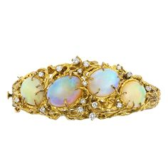 the bracelet is a little too gaudy for my taste, but those opals are beauty.