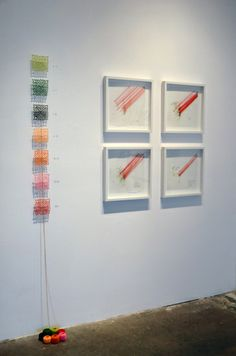 Lisa Solomon  fukushima daichii radiation chart + 4 drawings, 2012, crochet doilies, pins, thread balls, graphite on wall, 78 x 7 inches - doily install - drawings 16 x 16 inches each