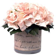 """Silk hydrangea arrangement in a pot with a French motif.  Product: Faux floral arrangementConstruction Material: Silk and glassColor: PinkFeatures:  Indoor useIncludes faux hydrangeas in French cotton ribbon pot Dimensions: 9"""" H x 9"""" Diameter"""