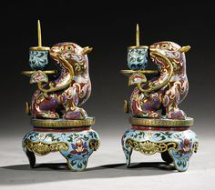 xx..tracy porter..poetic wanderlust...- A Pair of Chinese Cloisonne Enamel Lion Form Pric