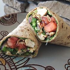 Thai peanut chicken wrap for lunch! Used a flatout wrap with chicken, spinach, avocado, red onion, cilantro, tomato and a locally made spicy thai peanut sauce. Instagram - goodhealthgoodvibes