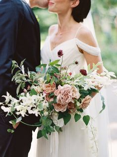 My bouquet was comprised of distant drum roses, scabiosa, orchids, Russian olive, and clematis vine I Lauren Balingit Photography