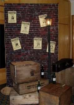 Roehampton Club London - Prohibition themed party: Set piece includes brick wall backdrop, wanted posters, Victorian street lamp, trunks and chests plus Moonshine bottles by www.stressfreehire.com #venuetransformers