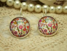 ● Beautiful Glass cabochon earring Handmade by Jess.  ● The Earring are produced within 1-2 days.    Order includes:  ● All items arrive nicely pac...