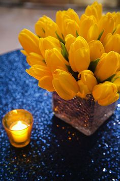 How exquisite is this combination of blue and yellow decor illuminated by the glow of votive candles?