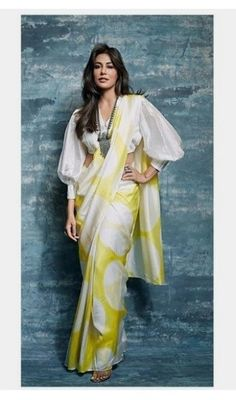 5 Blouse Styles Which Are Worth Having In Your Wardrobe – Fashion in India – Threads Modern blouses are experimental and also look chic. Discover These Latest Fashion Blouse Styles Which Are Worth Having In Your Wardrobe At Threads. Indian Blouse Designs, Saree Jacket Designs, Saree Blouse Neck Designs, Saree Blouse Patterns, Designer Blouse Patterns, Fancy Blouse Designs, Dress Designs, Trendy Sarees, Stylish Sarees
