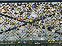 Love locks on the Pont des Arts, Paris. Lock with your love, and throw the key into the Seine. (This a huge reason why I want to go to Paris for my honeymoon.)