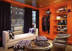 Someday my dressing room will look like this...  Orange lacquered walls in Tory Burch's Madison Avenue Boutique.