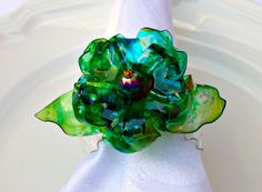 Peacock Plastic Bottle Flower compliments matching Cake Topper recycled art centerpiece blue green upcycled recycled eco friendly flower. $10.00, via Etsy.