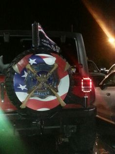 Sick spare tire cover on a Jeep.