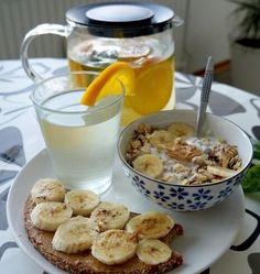 Healthy breakfast.. multigrain toast with nut butter and banana. andgranola cereal or oatmeal with fruit. with lemon water