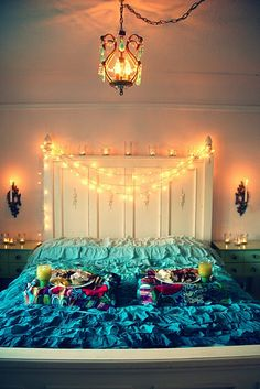 bed and Christmas lights as bedroom decorations.
