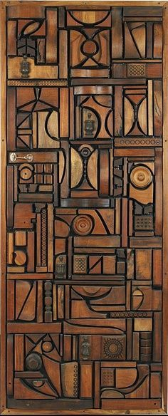 Hard to find the door knob in this beautiful door. KILLER design, love the crazy geometrics & what incredible carving!!