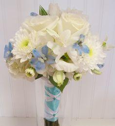 clutch bouquet of pale blue delphinium,white roses,lisianthus and cushion poms