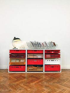 Industrial Decor: Red plastic crates used as drawers = inexpensive! (IF you can find these... where to get these?? what were they originally used for? they kind of resemble dish & glass racks used in restaurants)