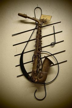 """Old saxophone turned into wall art! I like the idea.  It's a bit """"plain"""" for my tastes...but inspiration."""