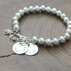 I love the statement this large ball bead, sterling silver bracelet makes, especially when personalized with your name, date or monogram | By 2 Sisters Handcrafted