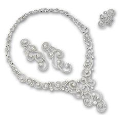 DIAMOND DEMI-PARURE.  Comprising: a necklace designed as intertwined diamond-set scrolls, interspersed by brilliant-cut diamonds, length approximately 400mm; a pair of pendent earrings of matching design; and a ring en suite; the diamonds altogether weighing approximately 15.65 carats, mounted in 18 karat white gold