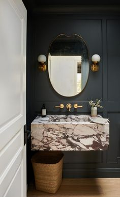 bohemian Bathroom Decor Moody modern powder room interior design with floating vanity and wall mounted brass faucet Powder Room Paint, Powder Room Design, Black Powder Room, Powder Room Decor, Bad Inspiration, Bathroom Inspiration, Bathroom Ideas, Bathroom Styling, Bathroom Baskets