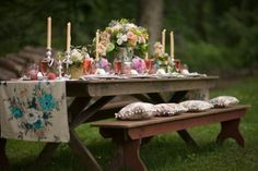 beautiful table setting picnic table with candles and runner