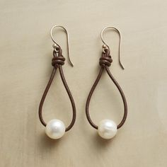 """PEARL LASSO EARRINGS--Earthy and elegant, tear-dropped leather loops lasso lustrous pearls, set asway on sterling silver wires. USA. Exclusive. 2-1/4""""L."""