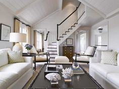Pretty room! And I love the soft turn of the staircase, and the contrasting colors of it.