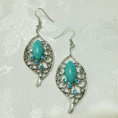 $10! 🎀🎁 NWT Turquoise teardrop dangle earrings Beautiful earrings! Turquoise stone in the middle (assuming synthetic?) and sparkley turquoise colored gems around it. About 2.75 inches long, as shown in last picture.   Cover shot shows my own pair, but you will receive an *unopened package*, as shown in 2nd picture.   *$10 if bundled!* - Just ask, I'll need to do it manually for you!   See the current Sale Ad at the top of my closet ⭐ Bundle & Save ⭐ or Make an offer! Jewelry Earrings