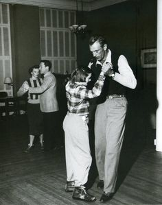 Gary Cooper shows his daughter Maria a few dance steps during a ski vacation in 1949.