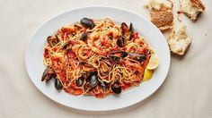 μακαρονάδα με θαλασσινά___This seafood spaghetti recipe is stocked with shrimp and mussels—and an extremely simple tomato sauce. Serve this with our Feast of the Seven Fishes menu. Shrimp Spaghetti, Seafood Pasta, Spaghetti Recipes, Mussels Seafood, Steamed Mussels, Clams, Summer Pasta Recipes, Shrimp Recipes, Fish Recipes