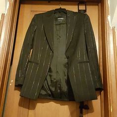 Authentic Giorgio Armani Blazer. Authentic Giorgio Armani black stripe blazer. Wore once. Size 42. Two front pockets and a closed upper hanky pocket. Still has inside tag attached with extra button. This is a one button blazer. No rips, tears and the pockets havent even been opened yet ( meaning thread broken) so u can put things into the pockets. There is one button on each sleeve. Giorgio Armani Jackets & Coats Blazers