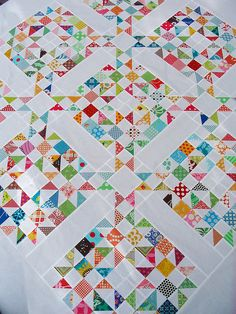 scrappy quilt - need to do one of these--vari-colored scraps with bright, bright white! So pretty!